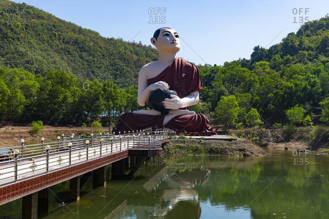 Myanmar- Mon state- outside of Mawlamyine- Statue of Buddhist monk at Win Sein Taw Ya