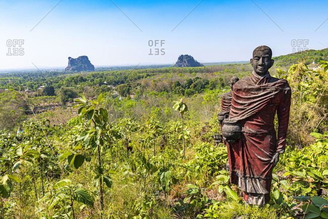 Myanmar- Mon state- outside of Mawlamyine- Buddhist monk statues in field at Win Sein Taw Ya
