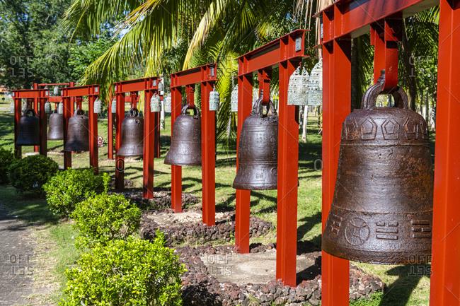 December 21, 2019: China- Hainan- Sanya- Row of large bells inside Nanshan Temple