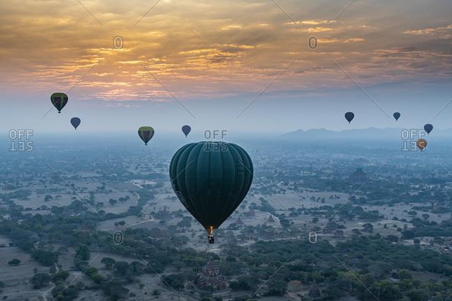 February 6, 2020: Myanmar- Mandalay Region- Bagan- Hot air balloons flying at foggy dawn