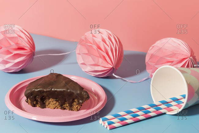 Chocolate cake- tissue paper pom-poms and paper cups and straws