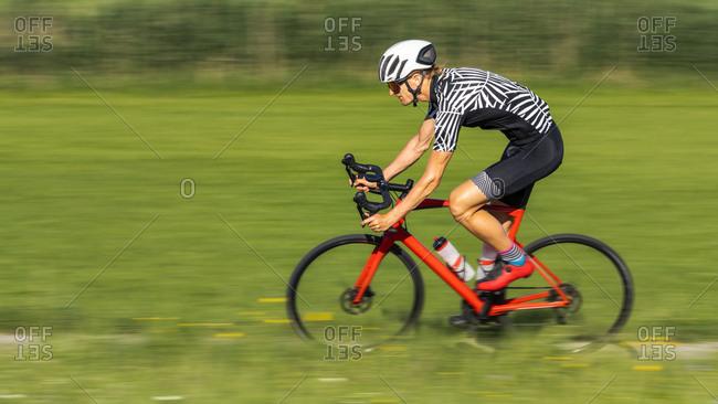 Man riding his racing bike