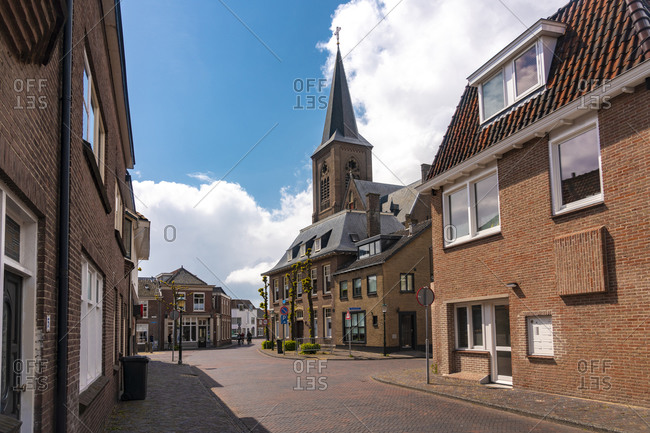 May 5, 2019: Netherlands- South Holland- Noordwijk- Empty town street with church tower in background