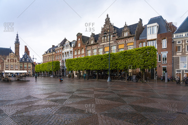 May 6, 2019: Netherlands- North Holland- Haarlem- Houses along empty Grote Markt square