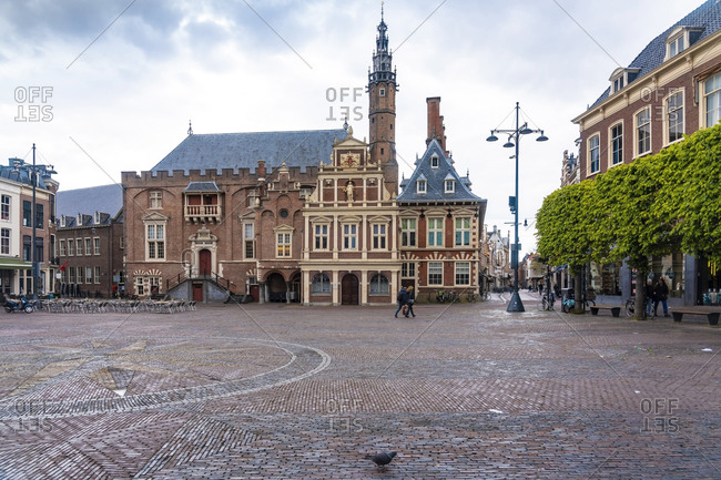 Netherlands- North Holland- Haarlem- Empty Grote Markt square with city hall in background