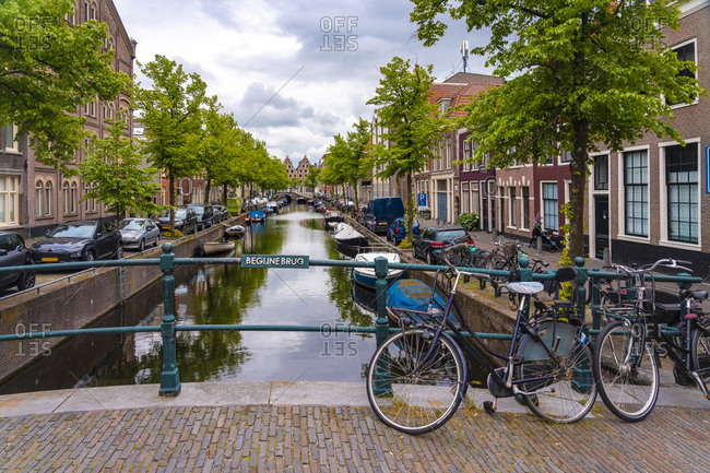 Netherlands- North Holland- Haarlem- Bicycles parked along railing of canal bridge