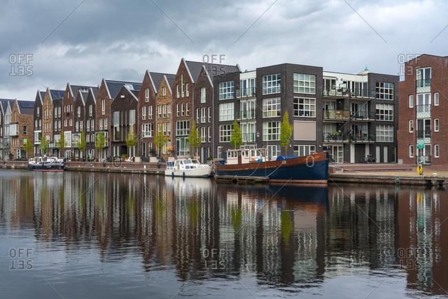 Netherlands- North Holland- Haarlem- Houses alongSpaarneriver canal