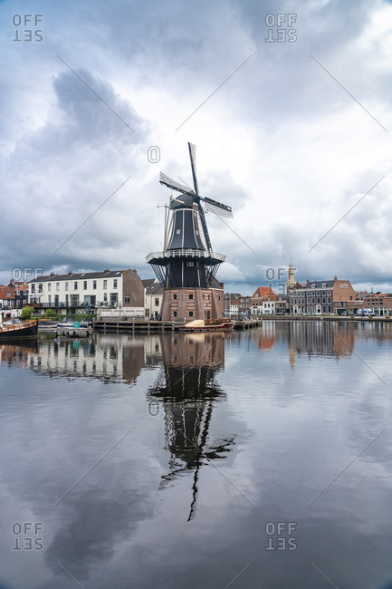 Netherlands- North Holland- Haarlem- Spaarne river canal and De Adriaan windmill