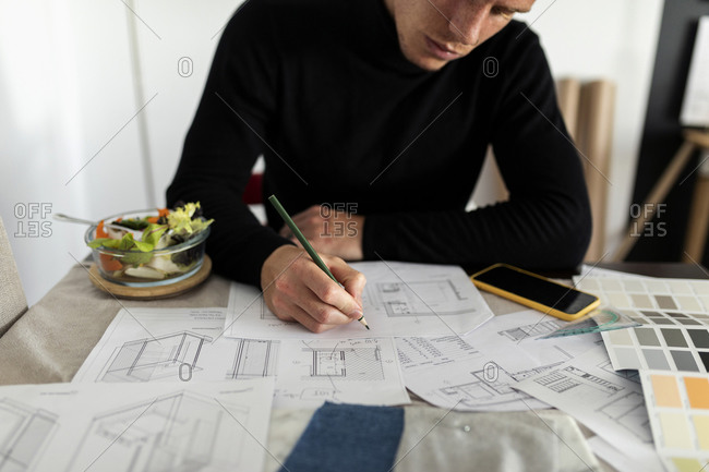 Male architect working on sketch at home office