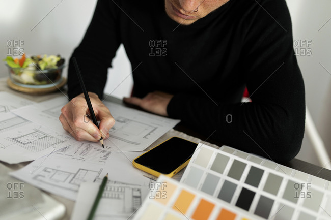 Male architect working on sketch at home