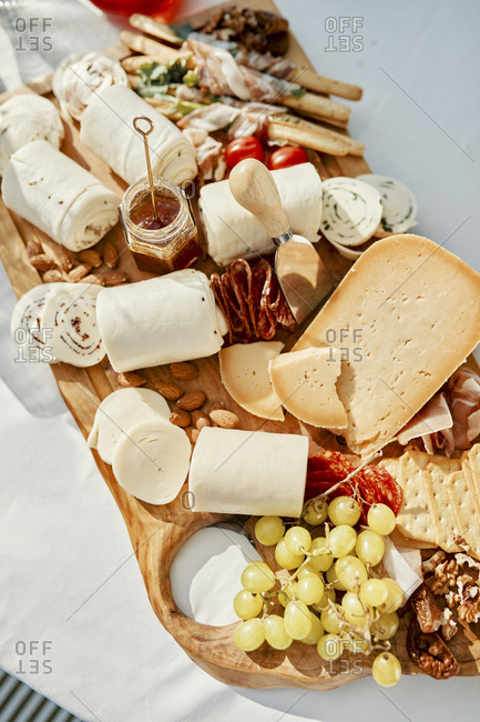 Cheese platter with meats and nuts