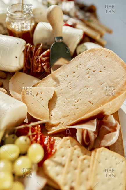 Cheese platter with meats and grapes