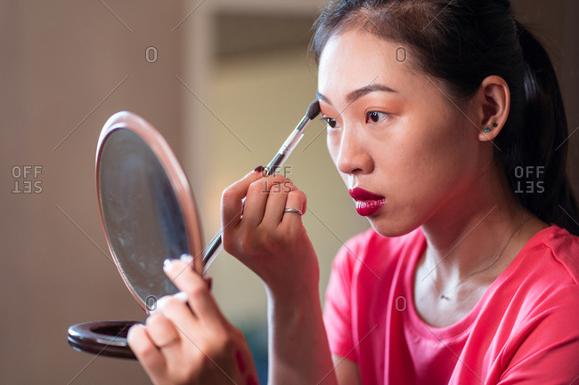 Beauty blogger applying makeup during shooting session