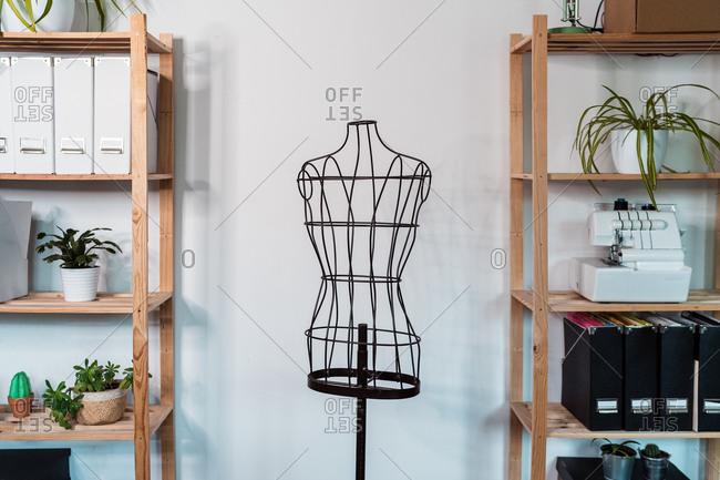 Wire dummy standing in modern loft style studio