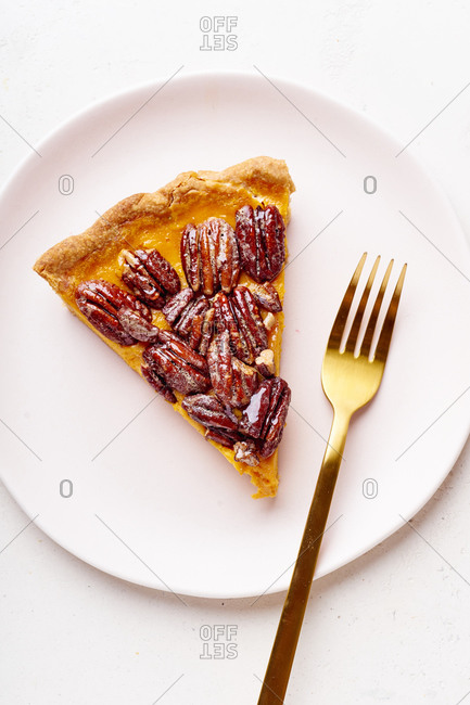 Overhead image of pecan pumpkin pie slice