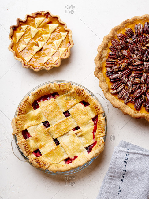 Variety of thanksgiving pies with berries, pumpkin and pecan