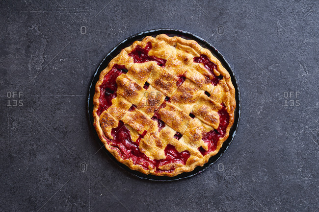 Top view image of cherry pie decorated with lattice