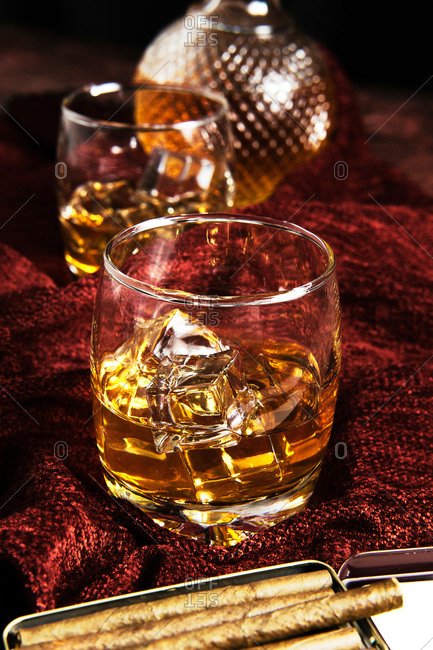 Close-up of two glass of whiskey on a table