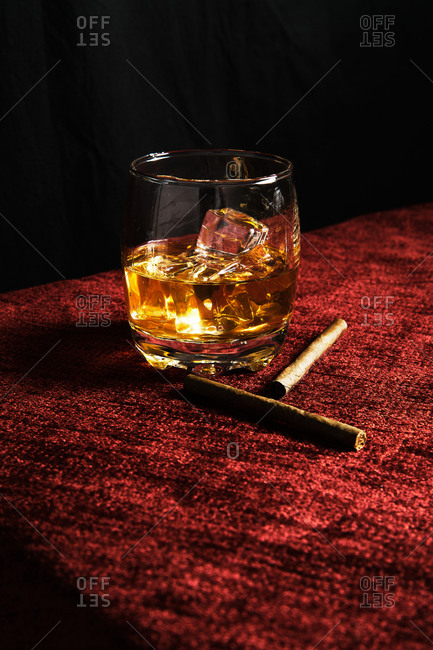Close-up of one glass of whiskey on a table