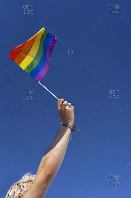 Arm waving LGBTQ pride flag