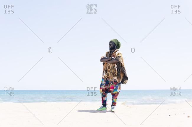 Rastafari man standing on beach
