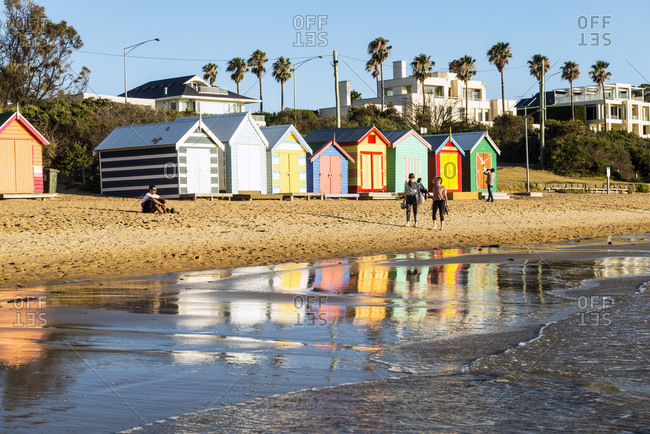 January 19, 2019: Brighton bathing boxes and reflections at low tide, Brighton Beach, Brighton, Victoria, Australia, Pacific