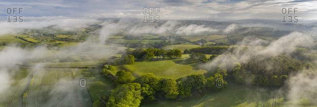 Aerial vista of Cadbury Castle Iron Age Hillfort, Devon, England, United Kingdom, Europe