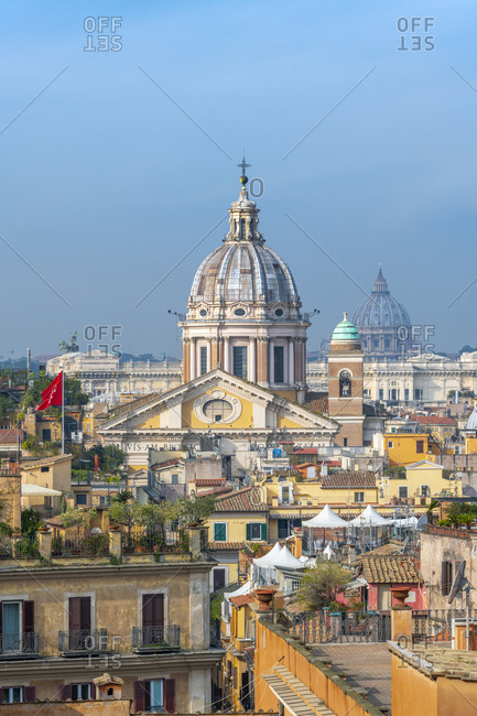 March 8, 2019: Basilica of SS. Ambrose and Charles on the Corso and St. Peter's Basilica and Vatican beyond, Rome, Lazio, Italy, Europe
