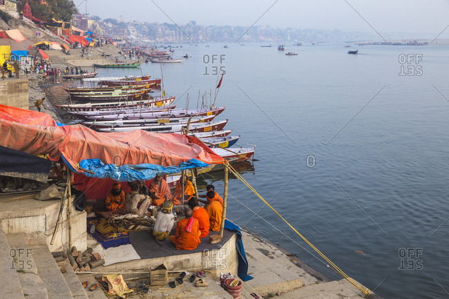 February 18, 2019: Hindu holy men on banks of Ganges River, Varanasi, Uttar Pradesh, India, Asia