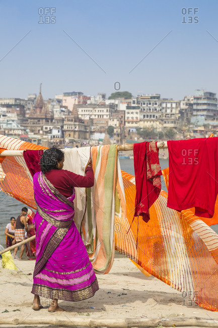 February 17, 2019: Hanging up washing on banks of Ganges River, Varanasi, Uttar Pradesh, India, Asia