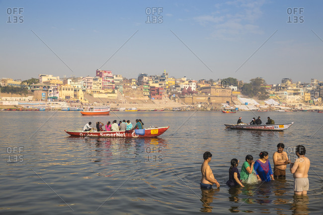 February 19, 2019: People bathing in Ganges River, Varanasi, Uttar Pradesh, India, Asia