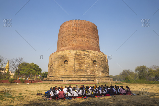 February 20, 2019: Pilgrims in front of the Dhamekh Stupa, Sarnath, Uttar Pradesh, India, Asia