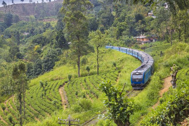 May 2, 2018: Kandy to Badulla train alongside tea estate near Nuwara Eliya, Nuwara Eliya, Central Province, Sri Lanka, Asia