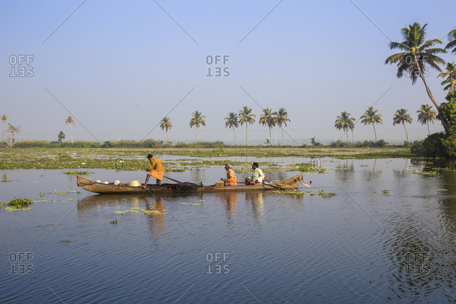 January 28, 2020: Men fishing from dugout canoe, Backwaters, Alappuzha (Alleppey), Kerala, India, Asia