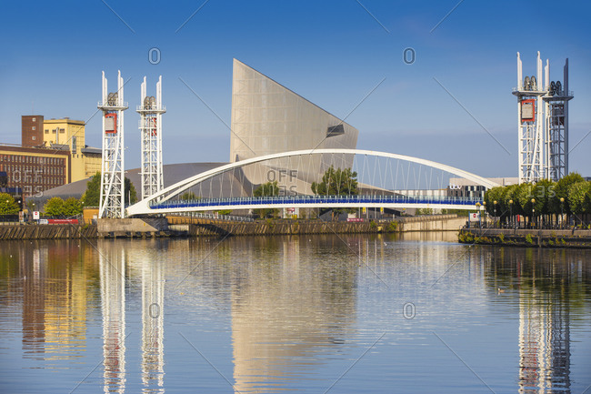August 16, 2015: The Lowry footbridge and Imperial War Museum North, Salford Quays, Manchester, England, United Kingdom, Europe