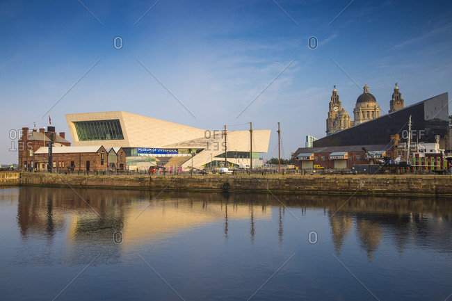 September 11, 2015: View of Pier Head buildings reflecting in Canning Dock, Liverpool, Merseyside, England, United Kingdom, Europe