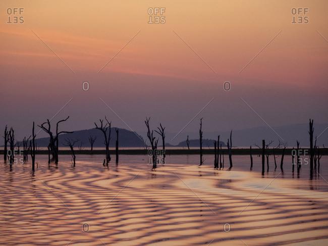 Sunset over Lake Kariba, the world's largest man-made lake and reservoir by volume, Zimbabwe, Africa