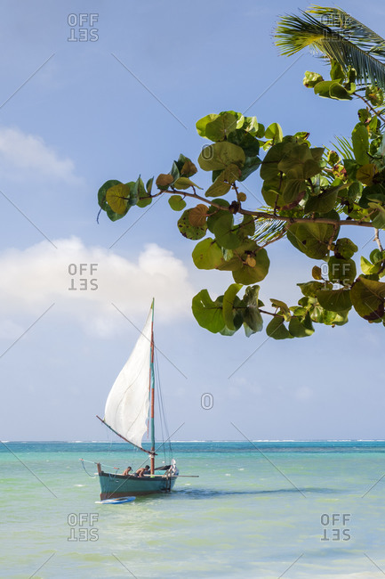 A traditional Caribbean wooden fishing sailboat in calm tropical sea, Nicaragua, Central America