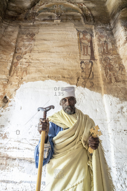 February 4, 2020: Orthodox priest holding the hand cross and prayer stick in Maryam Korkor church, Gheralta Mountains, Tigray Region, Ethiopia, Africa