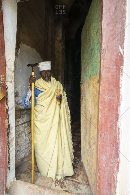 February 4, 2020: Orthodox priest holding the hand cross at the entrance of Maryam Korkor church, Gheralta Mountains, Tigray Region, Ethiopia, Africa