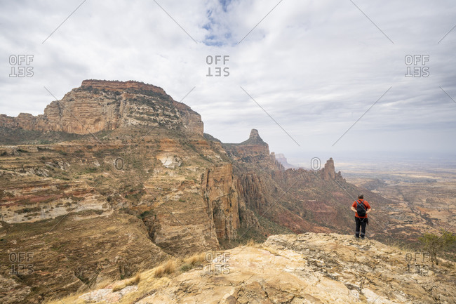 February 4, 2020: Male hiker admiring Gheralta Mountains canyons from top of rocks, Tigray Region, Ethiopia, Africa