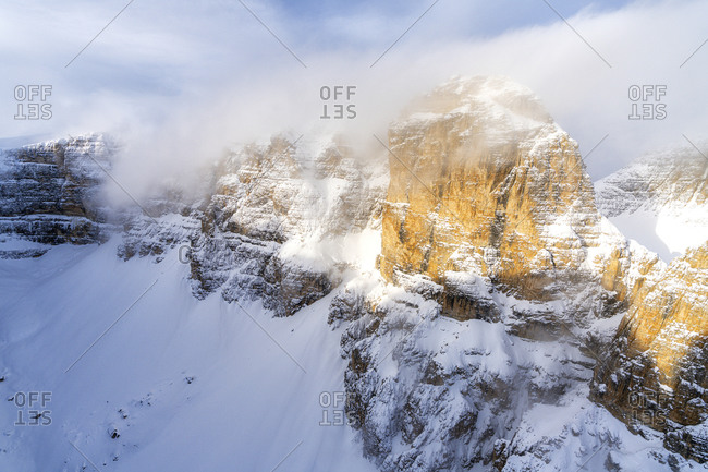 Mist over the rocky peaks of Sella Group during a snowy winter, Gardena Pass, Dolomites, Trentino-Alto Adige, Italy, Europe