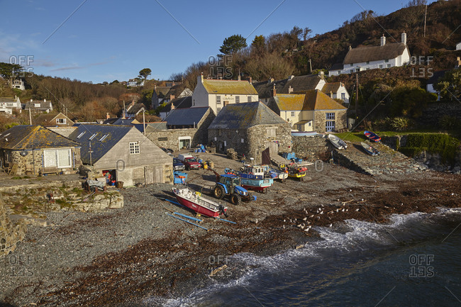 October 30, 2018: Fishing boats pulled up on the shore at the fishing village of Cadgwith, on the Lizard peninsula, in west Cornwall, England, United Kingdom, Europe