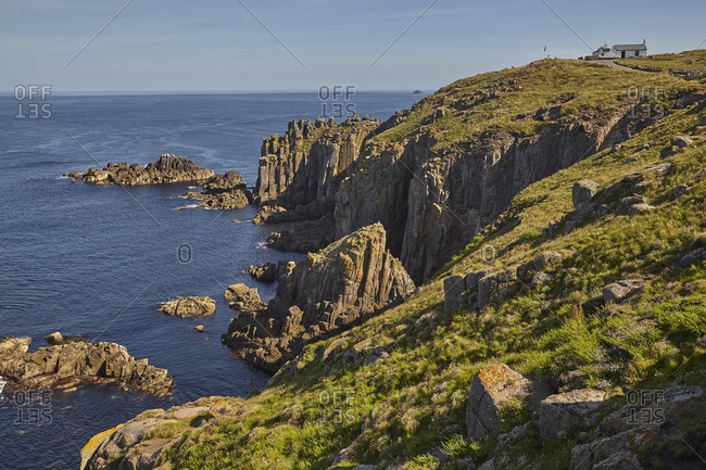 The rugged cliffs of Land's End, Britain's most southwesterly point, in calm summer weather, near Penzance, west Cornwall, England, United Kingdom, Europe