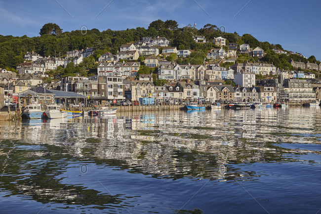 June 27, 2018: The well-known fishing harbor at Looe, in early morning sunlight, on Cornwall's south coast, Looe, Cornwall, England, United Kingdom, Europe