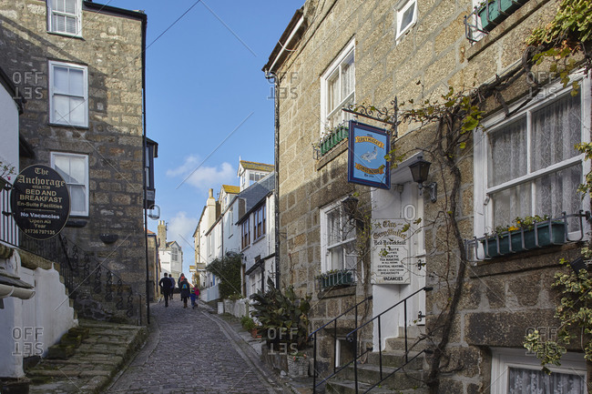 November 11, 2018: Old fishermen's cottages line narrow lanes in The Digey, the oldest part of the fishing harbor at St. Ives, in west Cornwall, England, United Kingdom, Europe