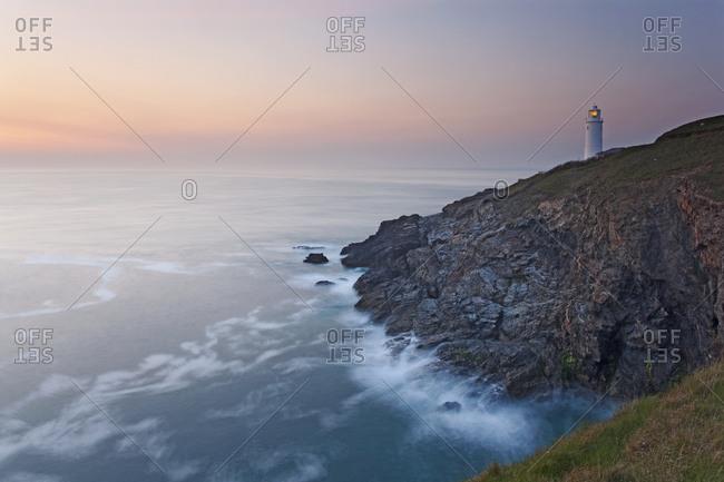 A peaceful dusk on Cornwall's Atlantic coast, showing the lighthouse at Trevose Head, near Padstow, Cornwall, England, United Kingdom, Europe