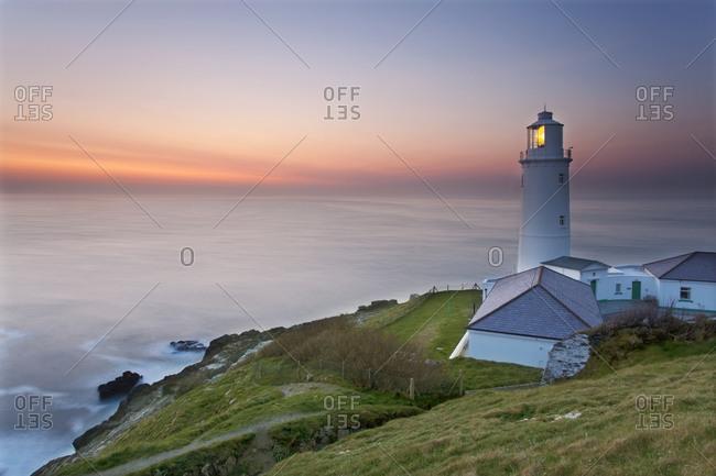A peaceful dusk on Cornwall\'s Atlantic coast, showing the lighthouse at Trevose Head, near Padstow, Cornwall, England, United Kingdom, Europe