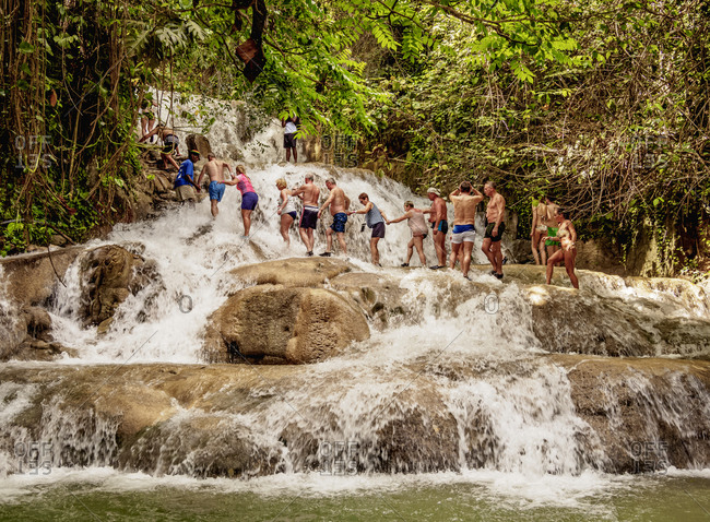 February 23, 2020: People climbing Dunn's River Falls, Ocho Rios, Saint Ann Parish, Jamaica, West Indies, Caribbean, Central America