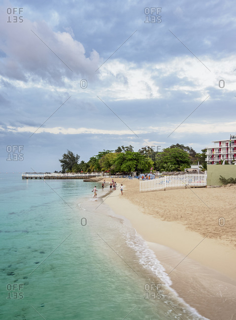 February 26, 2020: Doctor's Cave Beach at dusk, Montego Bay, Saint James Parish, Jamaica, West Indies, Caribbean, Central America